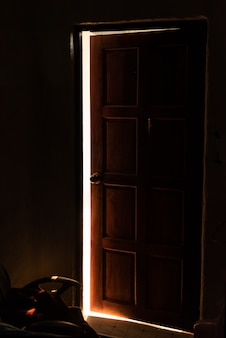 Bright warm light leaking from an opened door
