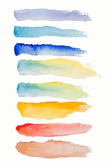 Bright watercolor blue yellow red pink stain brush stroke line.