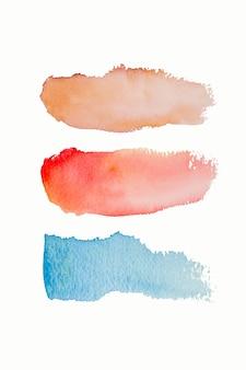 明るい水彩ブルーイエローレッドピンクステインドロップ、ブラシストローク。 a