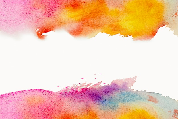 Bright watercolor paint yellow pink blue brush stroke. abstract background.