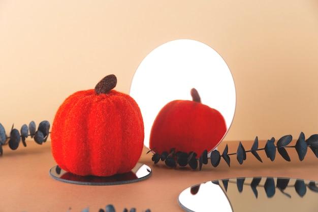 Bright woolen pumpkin with a round mirror