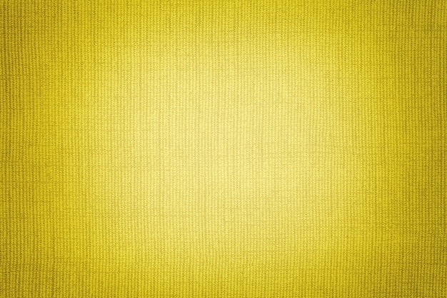 Bright yellow background from a textile material. fabric with natural texture. backdrop.