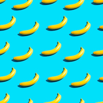 Bright yellow bananas on a blue background. seamless pattern.