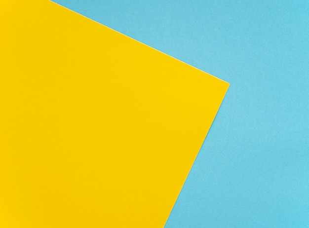 Bright yellow and blue sheets mockup colored blank  cardboard as texture