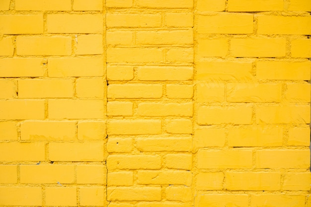 Bright yellow brick wall background in rural room,