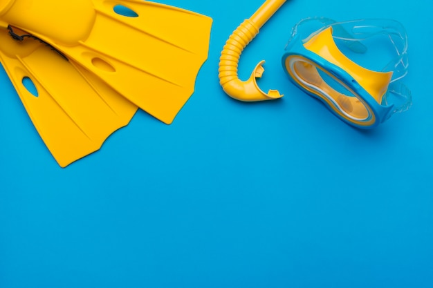 Bright yellow flippers and diving mask