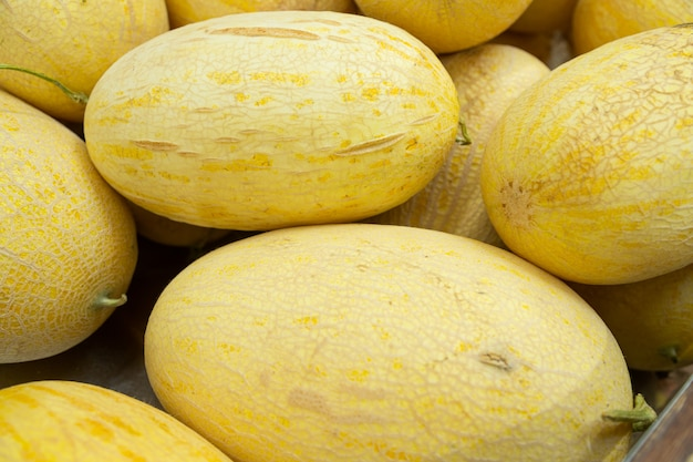 Bright yellow honeydew melon fruit close-up for background