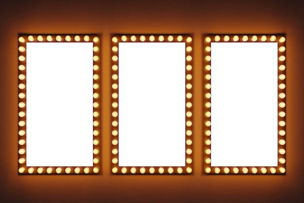 長方形の形で一列に並んだ明るい黄色の電球は、茶色の孤立した背景に点灯しています。電球が明るく輝く3つの白い長方形