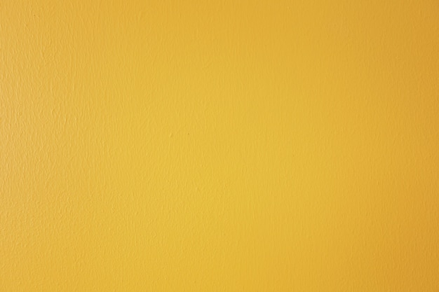 Bright yellow painted concrete wall background