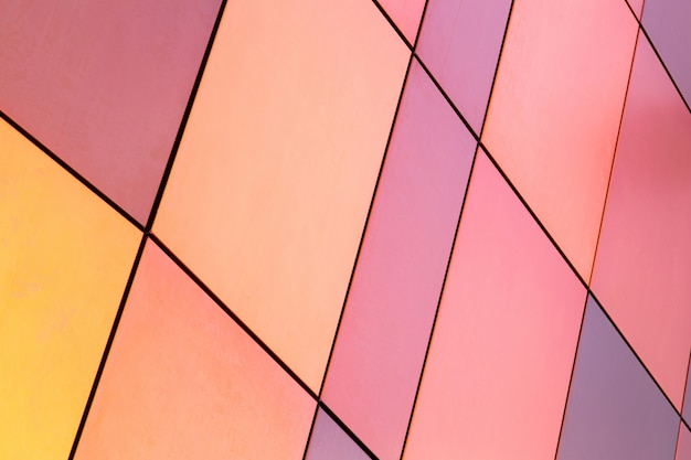 Bright yellow and pink, purple, salmon, plum color multicolored tile of different size for interior and exterior , diagonal view.
