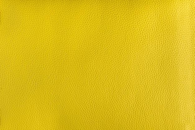 明るい黄色の滑らかな革の質感の背景