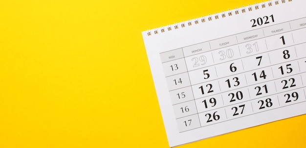 On a bright yellow surface is the 2021 calendar