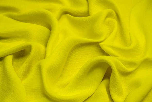 Bright yellow viscose fabric texture. background
