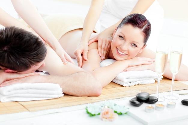 Bright young couple enjoying a back massage