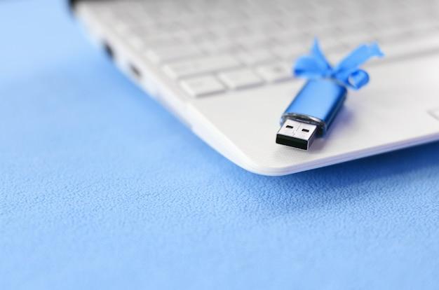 Brilliant blue usb flash memory card with a blue bow