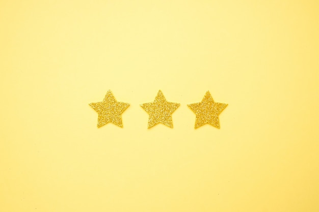 Brilliant glitter stars on a bright yellow  , rating 3 stars