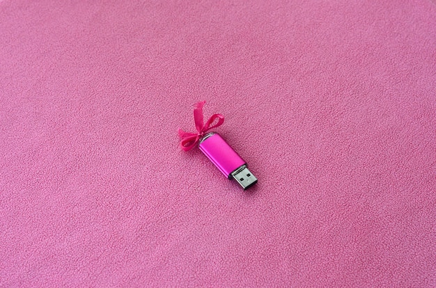 Brilliant pink usb flash memory card with a pink bow