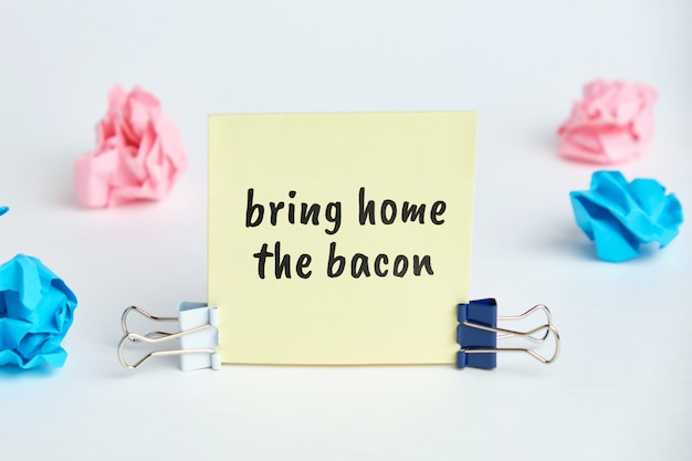 Bring home the bacon - english time idiom hand lettering on wooden blocks
