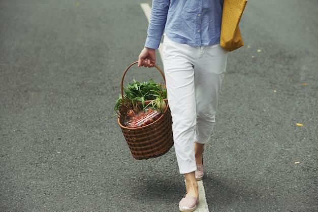 Bringing basket of vegetables