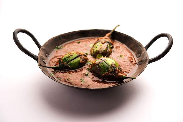 Brinjal curry also known as spicy baingan or eggplant masala, a popular main course recipe from india served in a bowl, karahi or pan