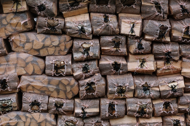 Briquettes with firewood. firewood in transparent mesh bags