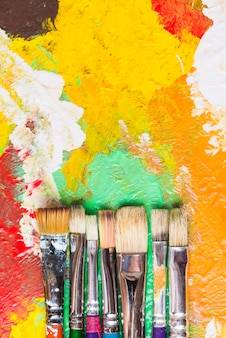 Bristle paintbrushes on bright strokes