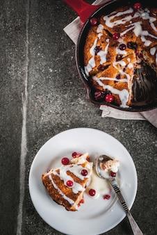 British english traditional pastries. cookies pie cranberry scones with orange peel, with sweet white glaze