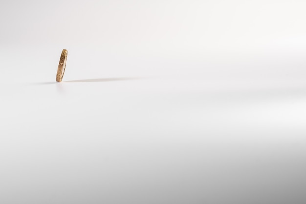British pound coin falling on white background, isolated