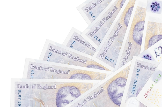 Закладки британских фунтов, лежащие в разном порядке на белой поверхности