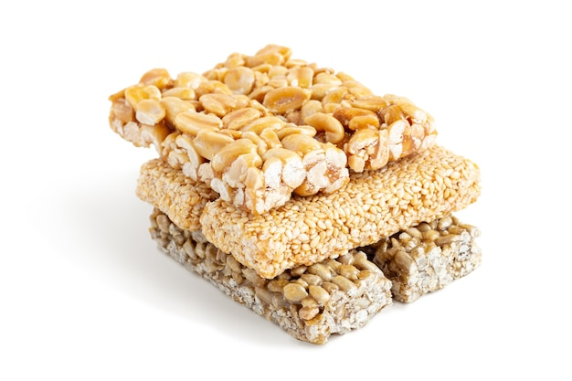 Brittle bars made of peanut and sesame seeds isolated on white