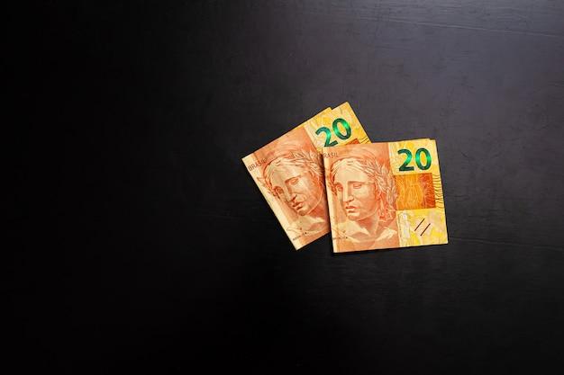 Brl real money bills from brazil on a dark surface