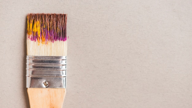 Broad brush with paint