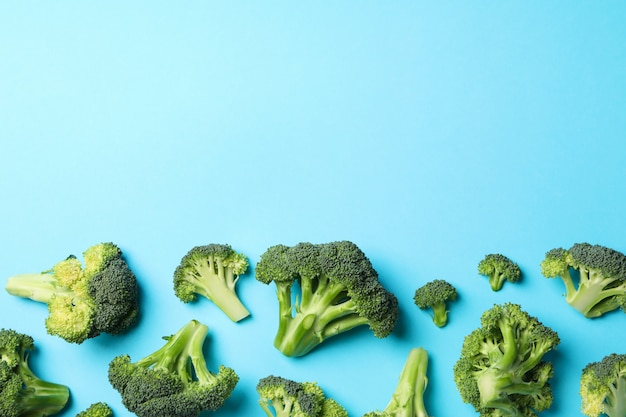 Broccoli on blue, top view. healthy food