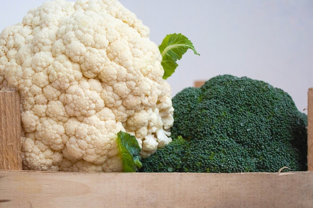 Broccoli and cauliflower are in a wooden box. the concept of proper nutrition