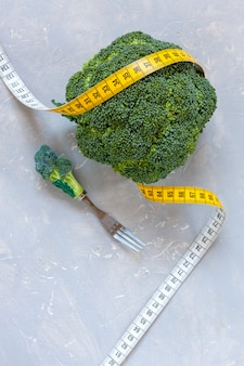 Broccoli and centimeter. fresh vegetable, concept for weight loss, diet, ketogenic diet, intermittent fasting
