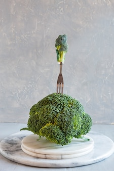 Broccoli and fork. fresh egetable, concept for weight loss, diet, ketogenic diet, intermittent fasting