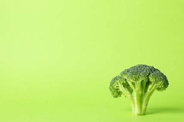 Broccoli on green, space for text. healthy food