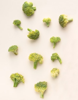 Broccoli on a light pink surface. view from above