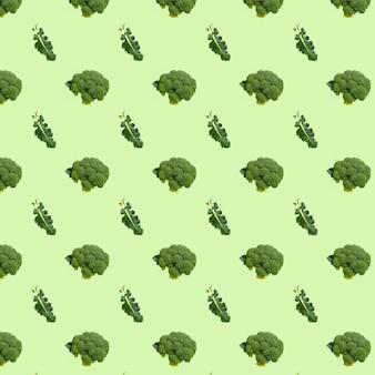 Бесшовный узор брокколи на пастельно-зеленом фоне