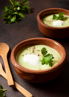 Broccoli soup winter food in bowls with parsley