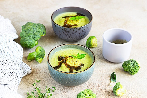 Broccoli or spinach green soup with aromatic spicy oil in bowl. vegan healthy food.