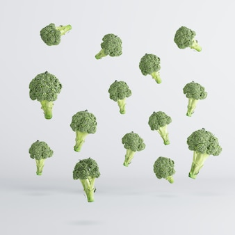Broccoli vegetable floating on white background. minimal idea food concept.