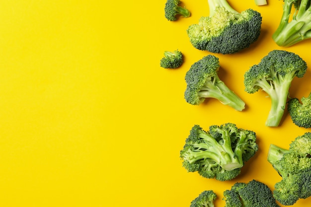 Broccoli on yellow, top view. healthy food