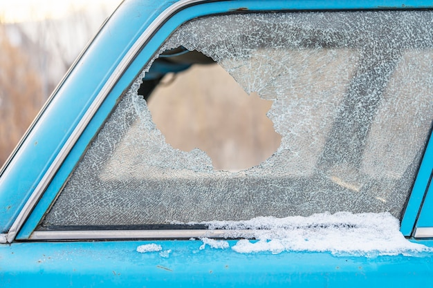 Broken car window, a hole in the glass, an insurance claim.