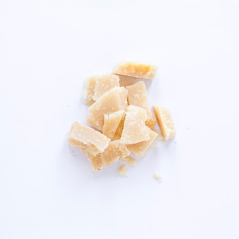 Broken cheese isolated on white background