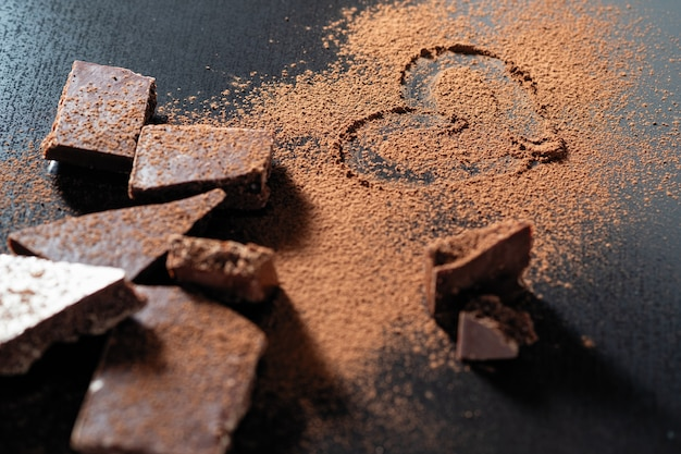 Broken chocolate bar, cocoa powder painted heart