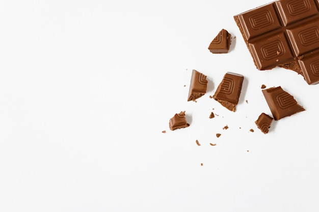 Broken chocolate bar on white background
