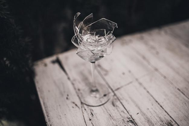 In a broken crystal glass wedding rings bride and groom