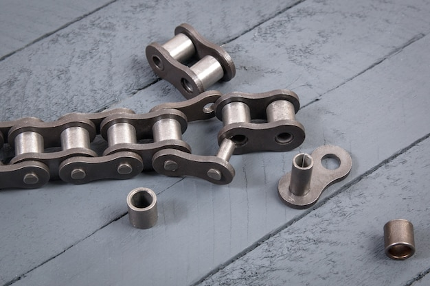 Broken driving roller chain. parts of destroyed industrial chain