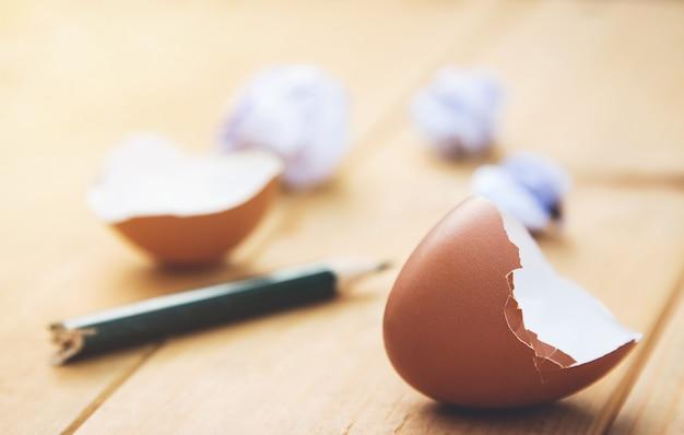 Broken egg peel with pencil